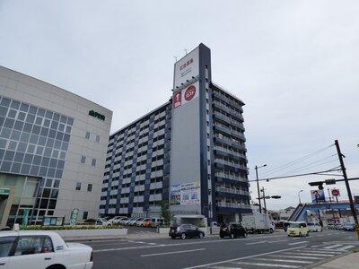 トーカングランドマンション第2南林寺シーサイド 県道沿い、11階建て分譲マンションの最上階。